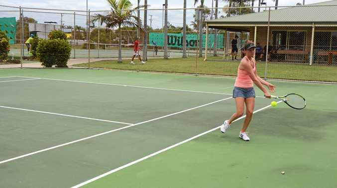 GOING HARD: Somer Della-Bona in action against Kaylah McPhee in the AMT final at Kawana Tennis Club.