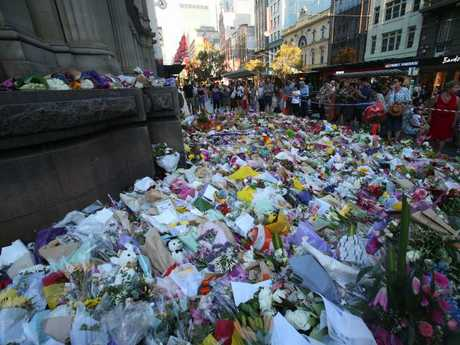 A flower memorial in Bourke St on Sunday evening.