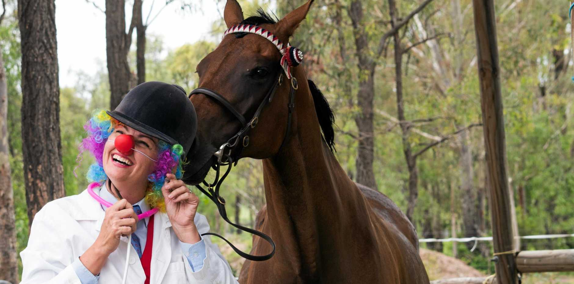 HUMOUR FOR HEALTH: Lockyer Equestrian Club secretary Kate Burns gets dressed up with her horse, Song Bird, for the club's hack day raising funds for the Clown Doctors.