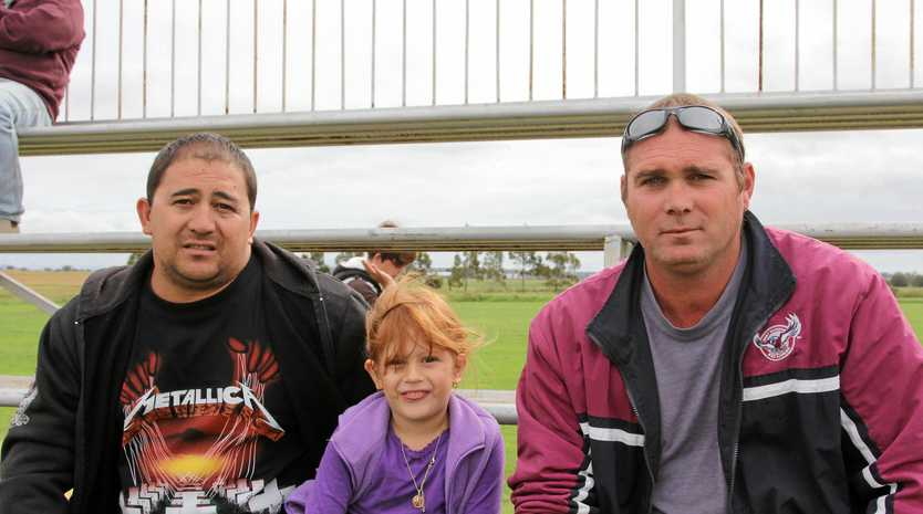 Past Killarney Cutters players and co-coaches Ray Wagner (left) and Leejay Cooper (right) with Ray's daughter Shayla at a Cutters game.