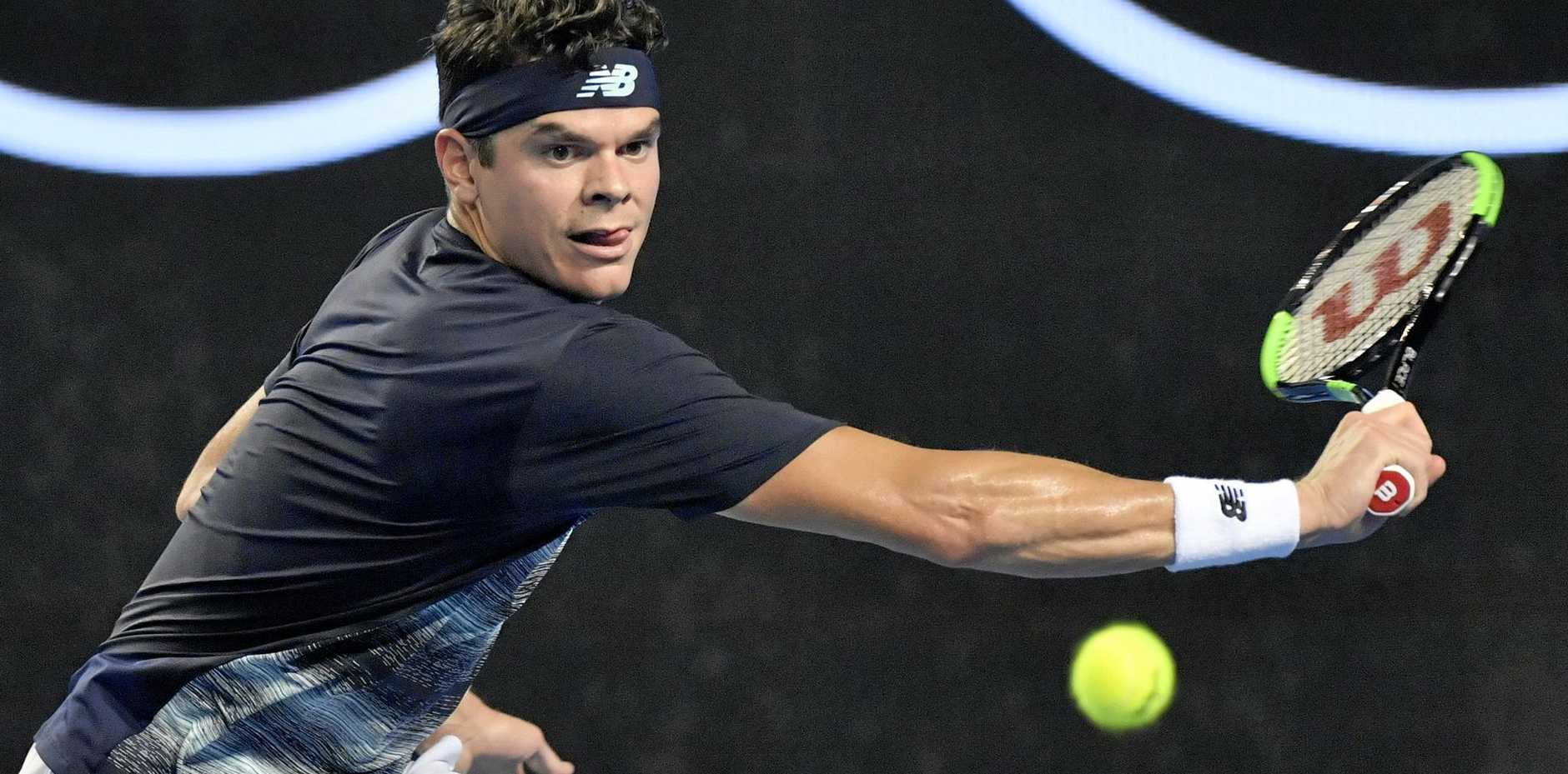 Milos Raonic of Canada faces off against Robert Bautista Agut of Spain during an Australian Open fourth-round match in Melbourne