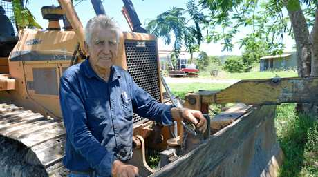 Bulldozer driver John Barrett worked with rural firefighters to build a firebreak around homes threatened by the Coolum bushfire.