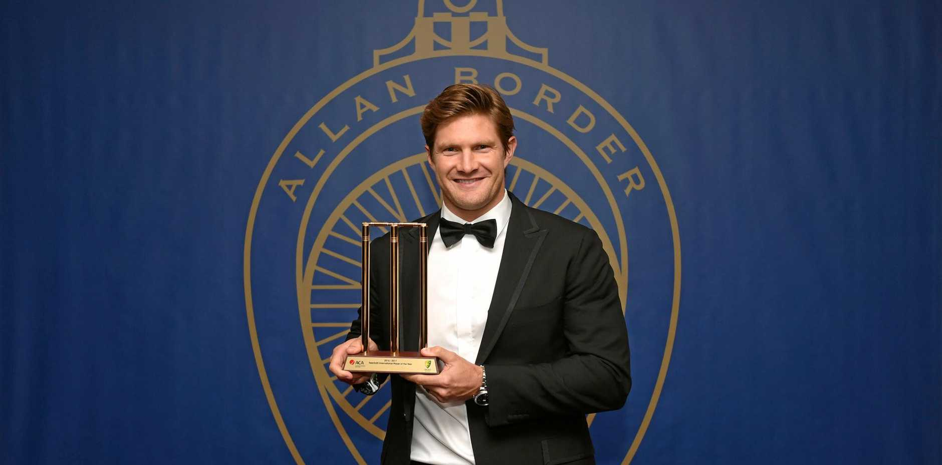 T20 Player of the Year Shane Watson poses for a photograph with his award at the Allan Border Medal award ceremony in Sydney
