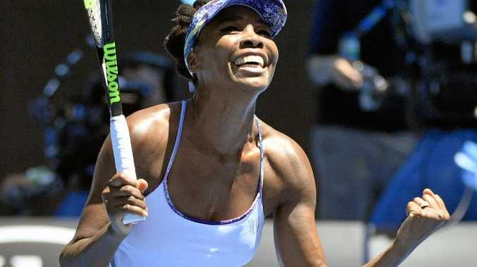 Venus Williams of the United States celebrates after defeating Anastasia Pavlyuchenkova of Russia.