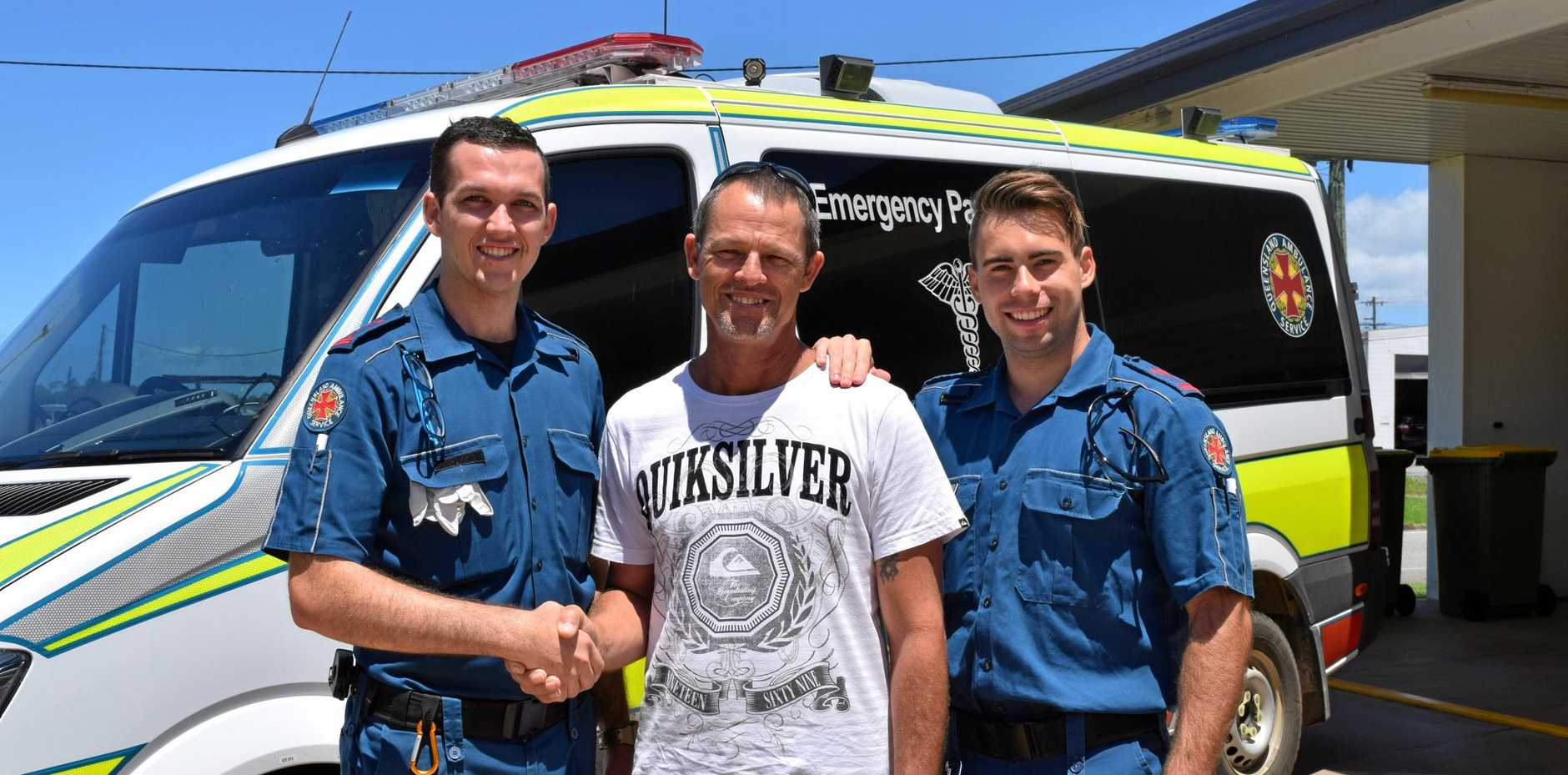 LIFE SAVERS: Reece Simon thanks paramedics Jordan Miles and Jordan Wacek for saving his life after a heart attack.