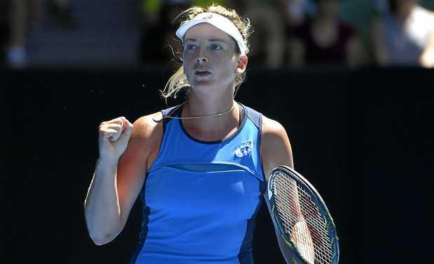 Coco Vandeweghe  celebrates her win over Garbine Muguruza at the Australian Open