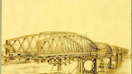 BRIDGE TO THE PAST: The Burnett Traffic Bridge was under construction today in 1900.