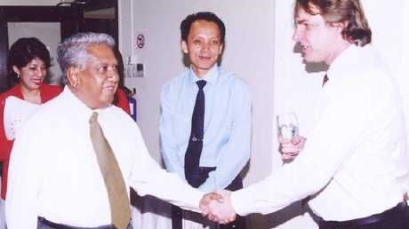 Dr John Tholen, right, with former Singaporean President S. R. Nathan