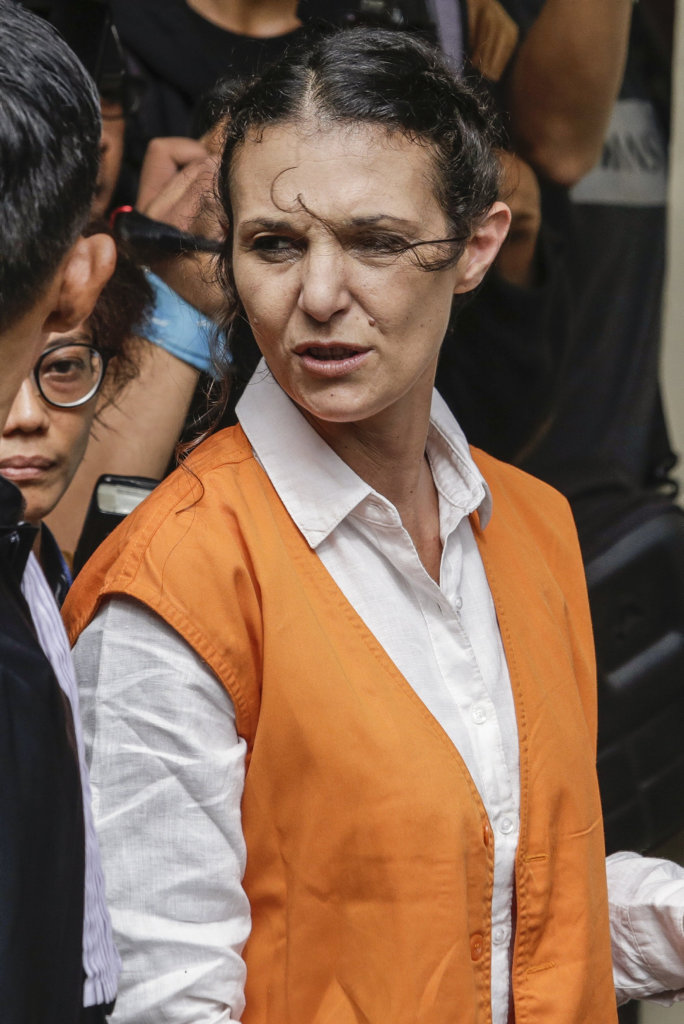 Australian Sara Connor being escorted by the prosecutor for her trial in Denpasar Court in Denpasar, Bali, Indonesia on Tuesday, Jan. 24, 2017. Her British boyfriend David Taylor will testify at Sara Connor trial regarding the murdering of a local police officer Wayan Sudarsa, whose bloodied body was discovered on Kuta Beach on August 17. (AAP Image/Johannes Christo)