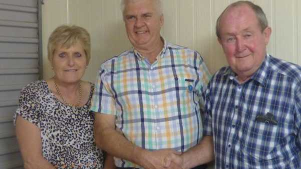Celebrating his life membership award is Toowoomba Canary Club Club's president Paul Smith (centre) with his wife Liz and club patron Graham Barron