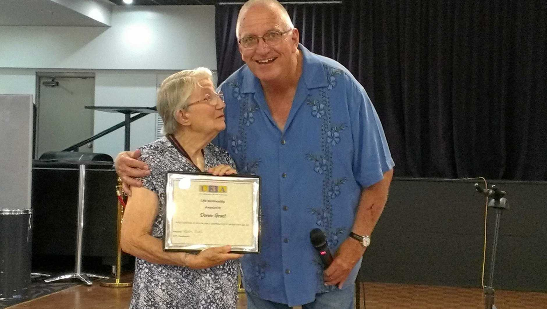 Doreen Grant is presented with her well deserved life membership by Hervey Bay U3A president Peter Wells.