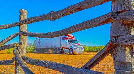 Old cattle yards frame the ProStar on a bush track.