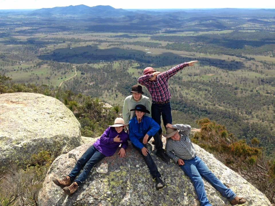 Several Mundubbera State School Year 7 Students on top of Mount Walsh.