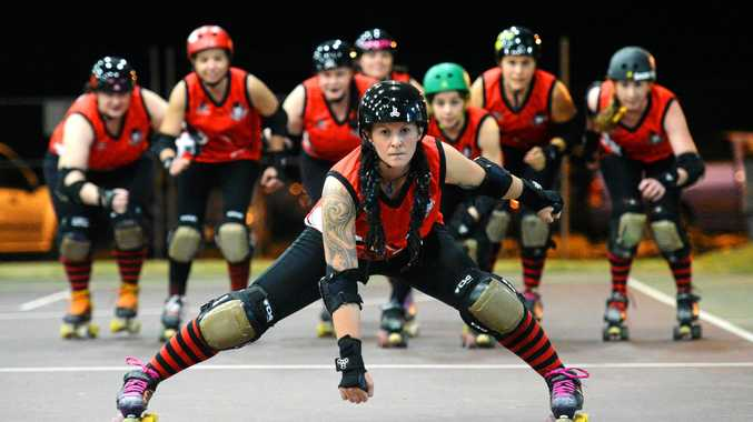 ROLL ON UP: Rum City Derby Dolls captain Dread'ful and her team.