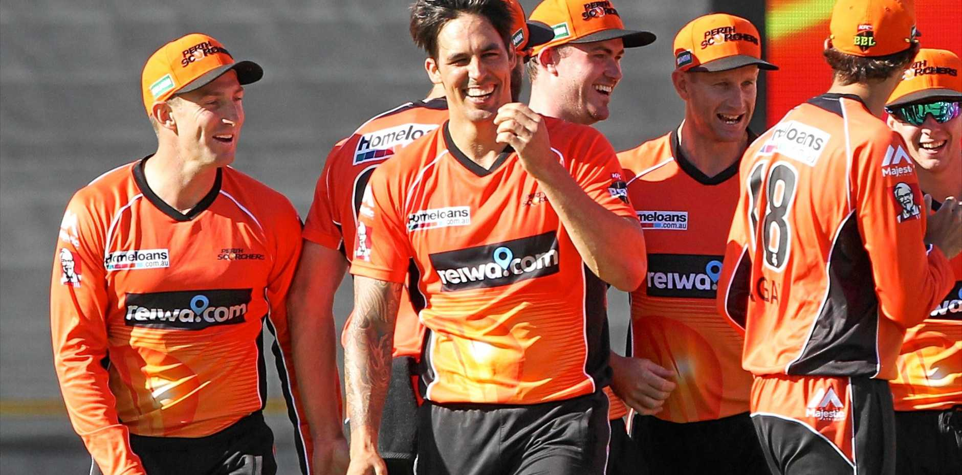 Mitchell Johnson (centre) celebrates dismissing Rob Quiney at the WACA.
