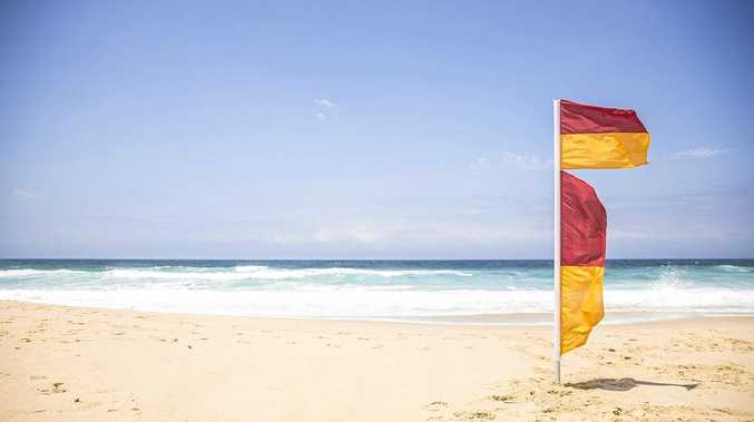 STAY SAFE: Always swim between the red and yellow flags. They mark the safest area for swimming.