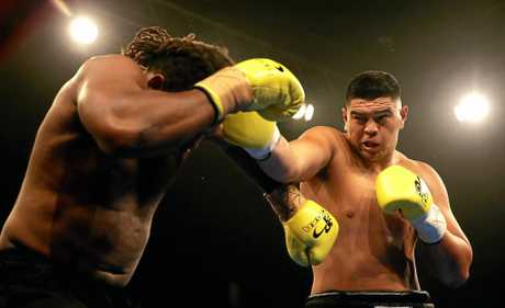 Willis Meehan throws a right at Freddie Miller during their heavyweight bout during the Footy Show Fight Night at Allphones Arena in 2015.