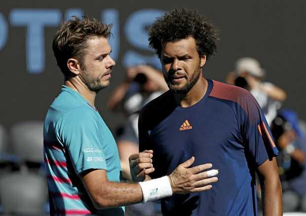 Switzerland's Stan Wawrinka, left, is congratulated by France's Jo-Wilfried Tsonga after winning their quarterfinal at the Australian Open