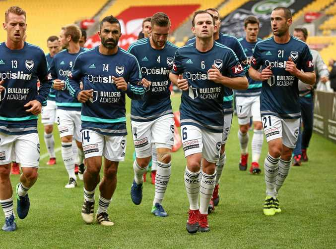 Leigh Broxham (front right) will play a club-record 225th A-League game for Melbourne Victory against Sydney FC.