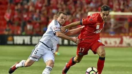 Leigh Broxham takes on Nikola Mileusnic of Adelaide United during their team's recent round-14 clash.