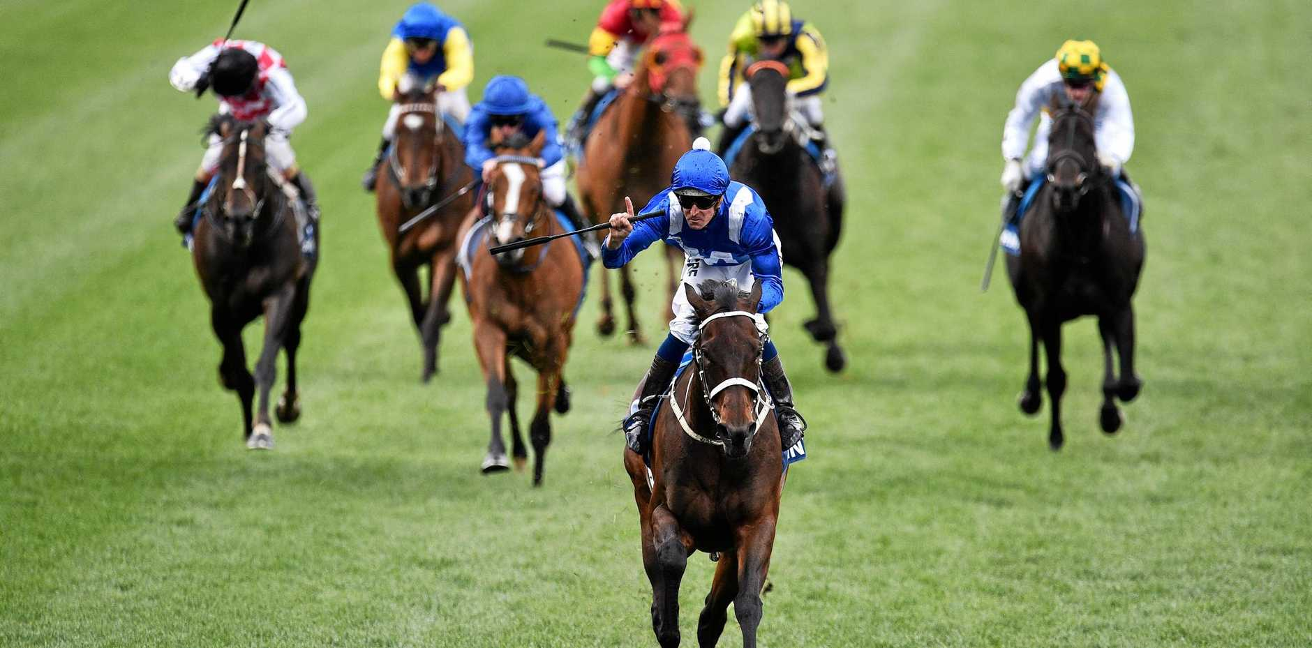 Hugh Bowman rides Winx to a dominant victory in the Cox Plate at Moonee Valley on October 22 last year.