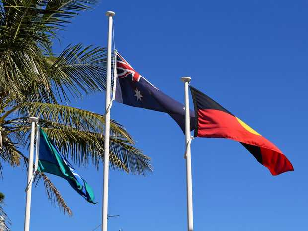HIGH AND PROUD: The Torres Strait Island, Australian and Australian Aboriginal flags.