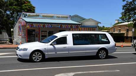 ONE LAST STOP: Traffic was stopped on the Bruce Hwy in Childers as Anthony Mammino's hearse paused outside the Mammino Gourmet Ice Cream store on January 25, 2017.