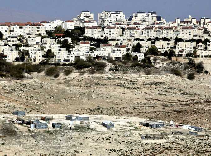 ILLEGAL: The settlement of Maaleh Adumim looms over Arab Bedouin shacks in the West Bank.