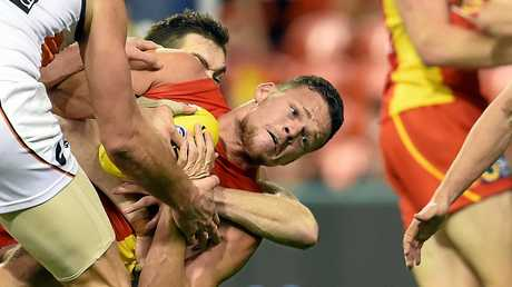 Steven May is tackled after taking a mark during a  game against the Great Western Sydney Giants