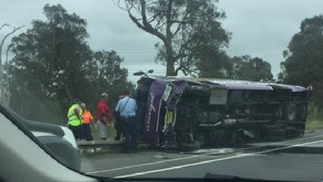 A minibus has rolled on the Princes Highway, near Albion Park, south of Sydney.