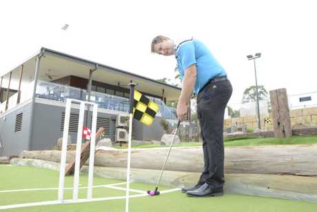 NOW OPEN: City Golf Club operations manager Andrew Webb tests out the new mini golf course at its driving range, which is now open.
