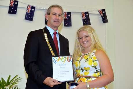 Australia day awards and Citizenship ceremony in Gympie Mayor Mick Curran presents Cultural award to Jamie-Lee Griffiths.