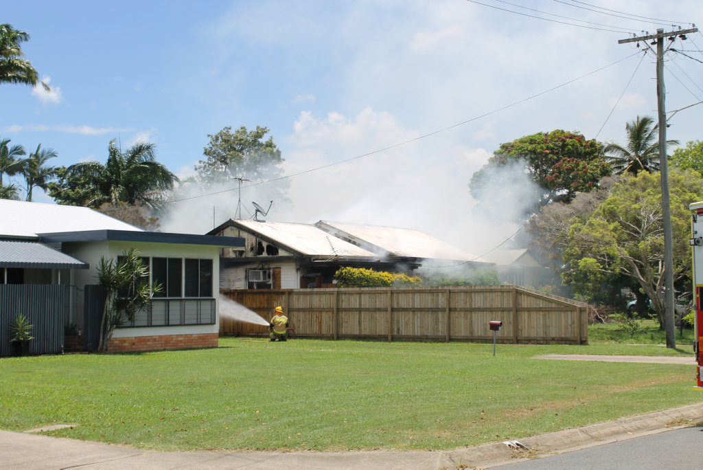 When firefighters at the scene of a house fire on Johnson St, West Mackay, the home was already completely ablaze, with a damaged side and front.