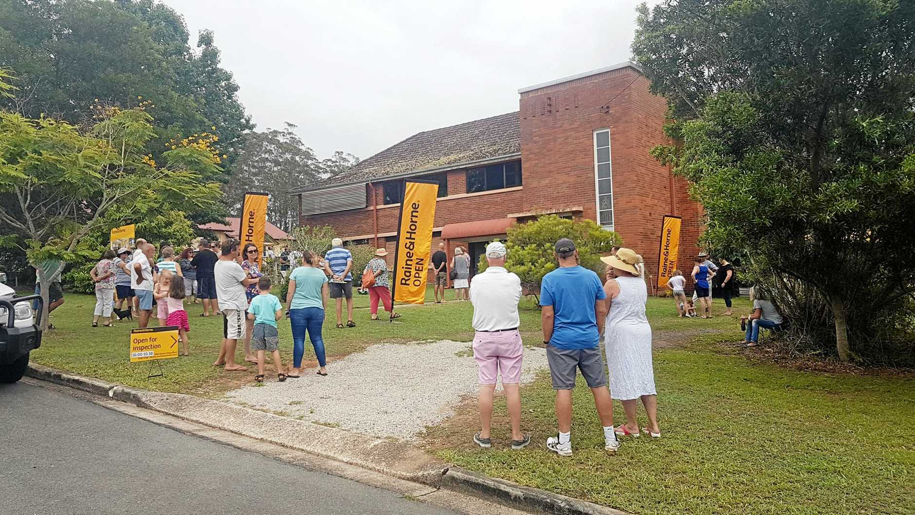 SUNDAY SERVICE: The auction of the former Catholic school now a residential property at 3 Church St, Pomona, drew a good crowd and bidding.