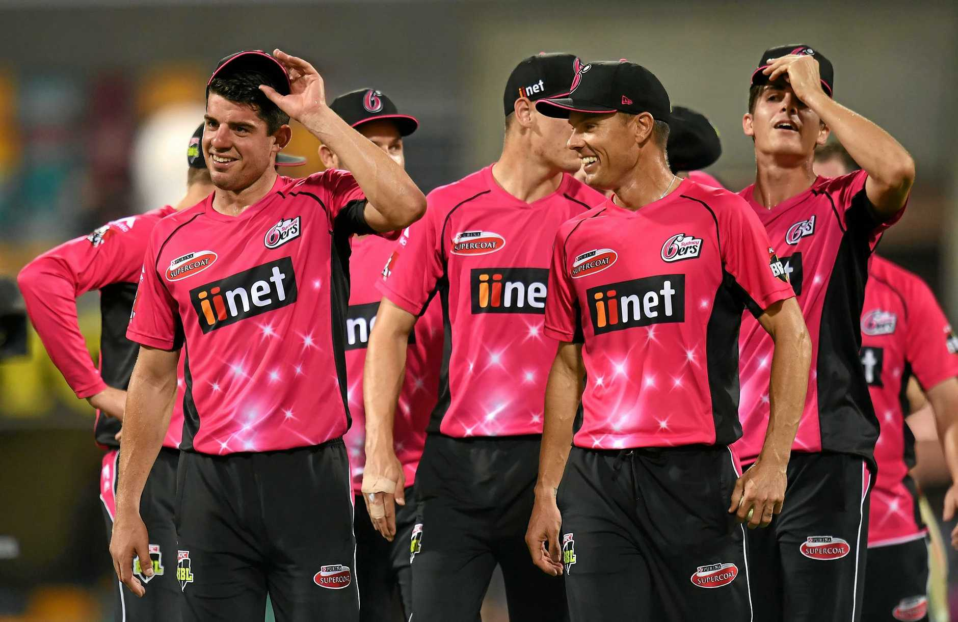 Sydney Sixers captain Moises Henriques (left) leads players from the field after winning the Big Bash League  semi-final