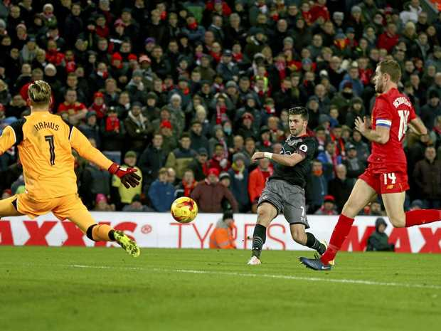 Southampton's Shane Long (centre) scores the winner against Liverpool.