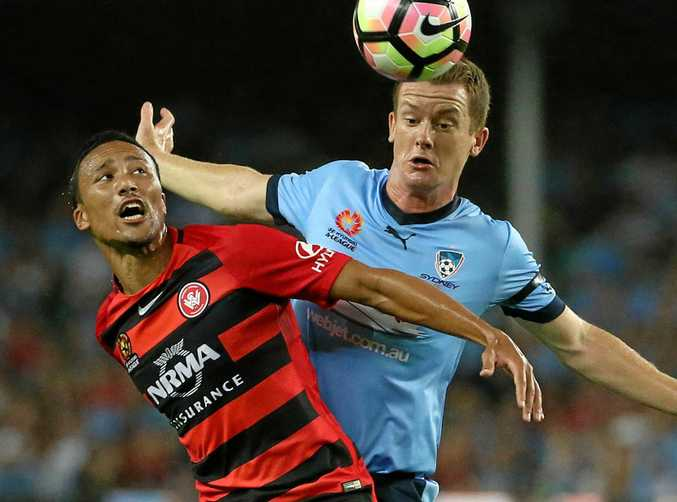 Western Sydney Wanderers player Kearyn Baccus (left) has been charged with assault.