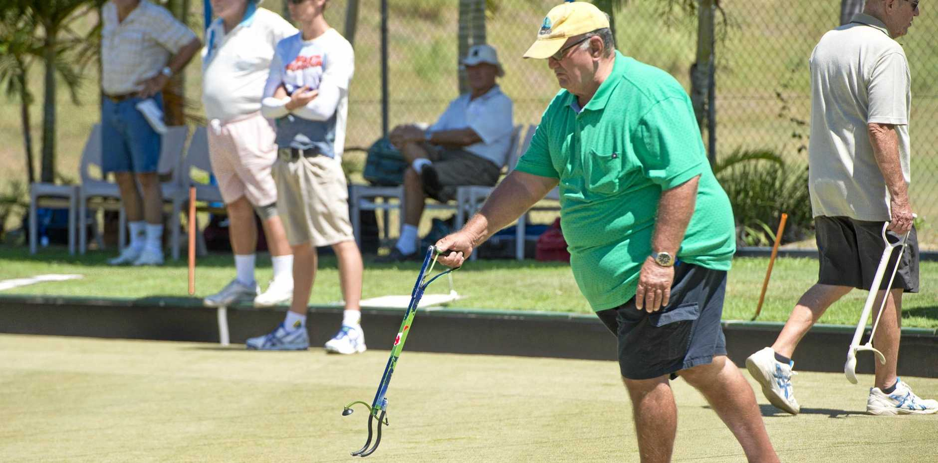 KEEN: Potential member Ken Worley demonstrates his bionic arm at the Alumina Bowls Club Open Day.