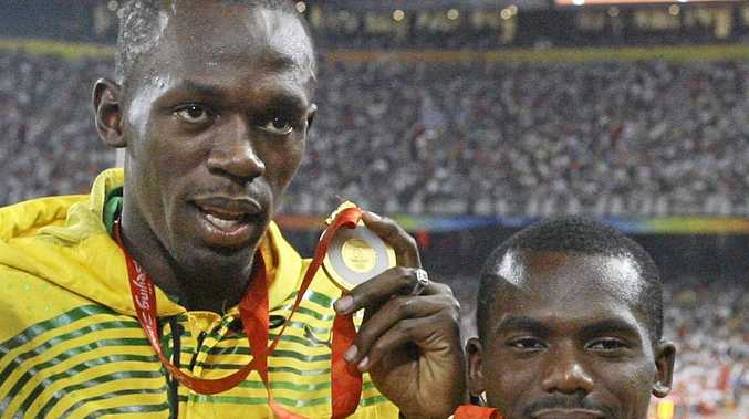 Usain Bolt celebrates with Nesta Carter after winning the 4x100m relay gold at the Beijing Olympics. The medal has now been stripped by the IOC.