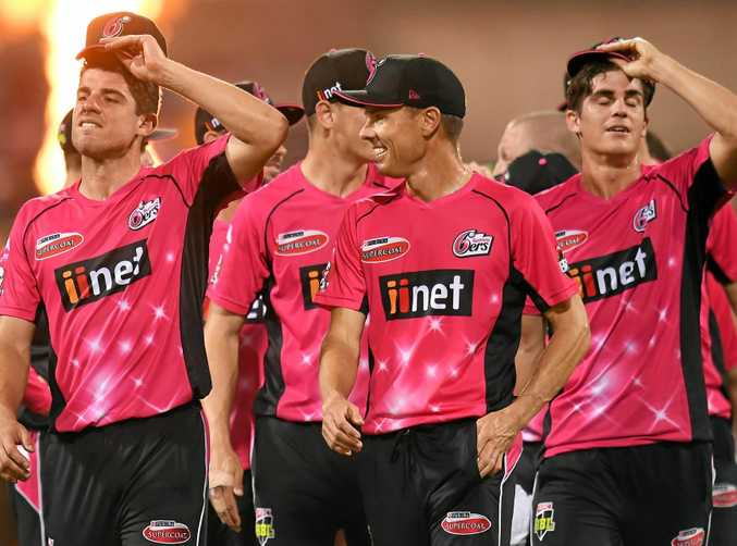 Sydney Sixers captain Moises Henriques (left) leads players from the field after winning the Big Bash League semi-final against the Brisbane Heat.