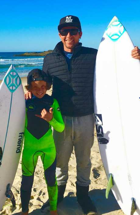 Eden Hasson, pictured with dad Chris, said the close encounter hasn't put either of them off surfing.