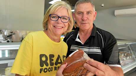 John Bulley donates meat prudcts to Michele Lipner from REAP.