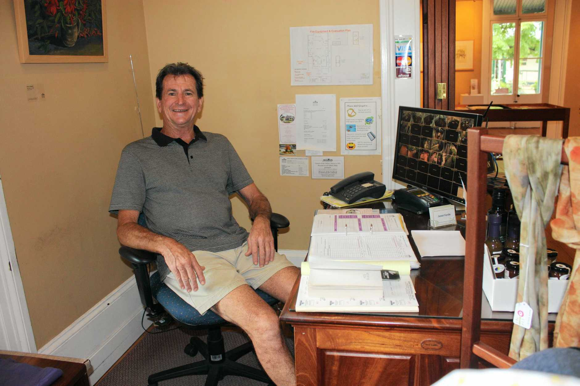 THE GOOD LIFE: Allan Palmer is right at home at the desk of Grafton Regional Gallery after 10 years as a volunteer.