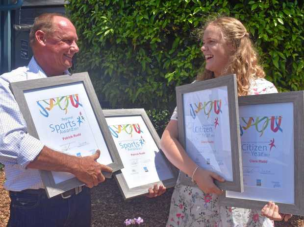 ALL IN THE FAMILY: Regional Young citizen of the Year Clara Rudd and her father Geoff accepted her brother Patrick's Regional Sports Award at the Australia Day Ceremony in Dalby.