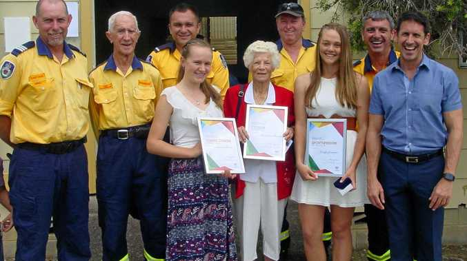 Back: Woodenbong Australia Day winners: Representative Members of the Woodenbong Rural Fire Brigade for Community Organisation. Front: Madeleine Barrett for Young Citizen: Nan Krurup for Citizen of the Year: Katelyn Grimmett for Junior Sportsperson and Alex Jones the Ambassador. PHOTO: JOYCE MARSH
