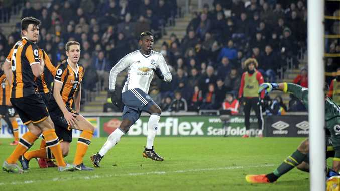 Manchester United's Paul Pogba (centre) scores against Hull.