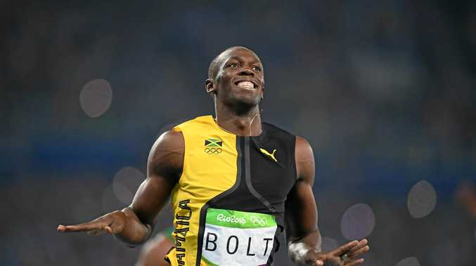 Usain Bolt of Jamaica celebrates after winning gold in the men's 100m final at the Rio Olympics.