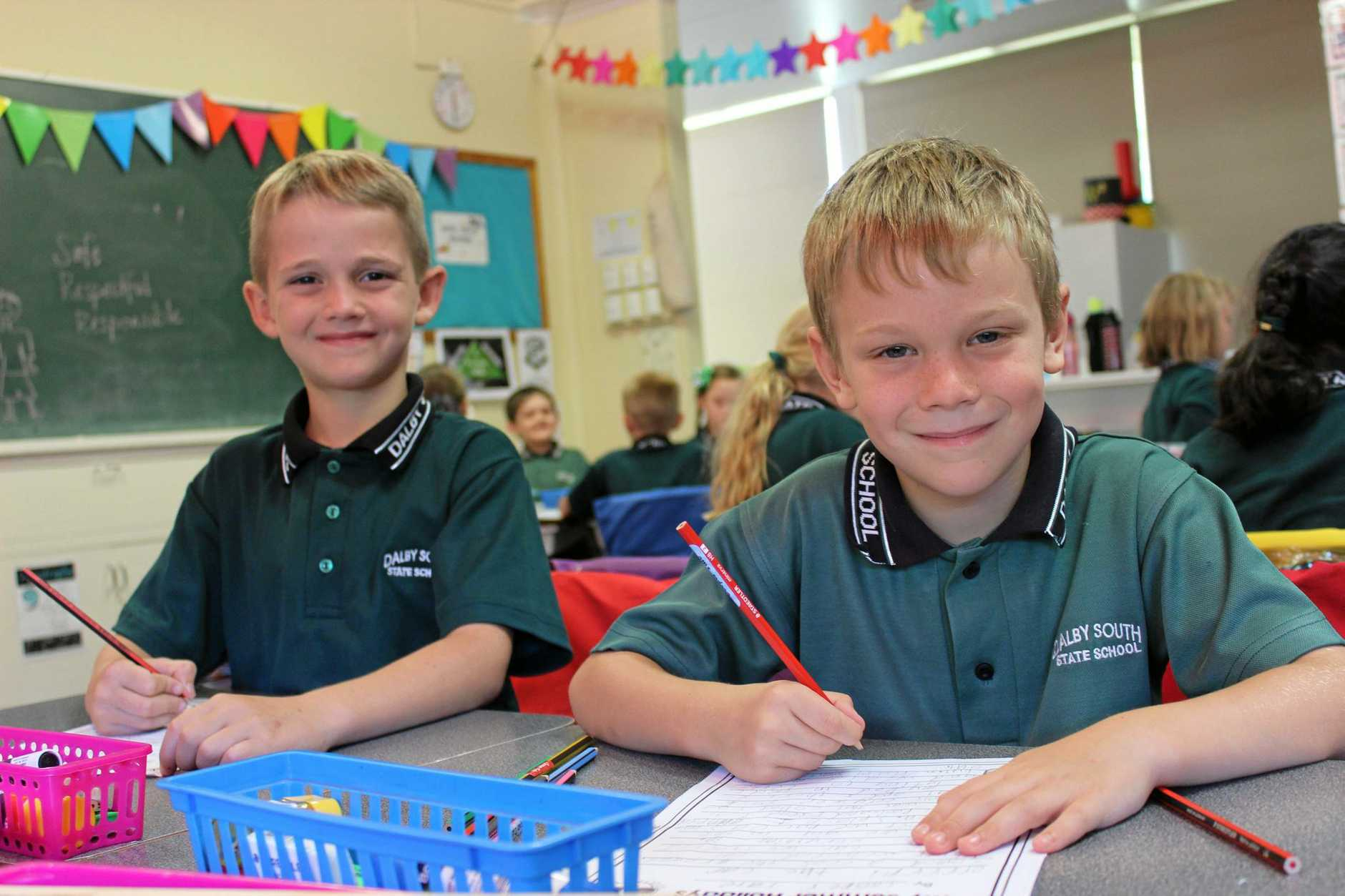HITTING THE GROUND WRITING: Patrick Pharaoh and Cooper Tate at Dalby South State School.