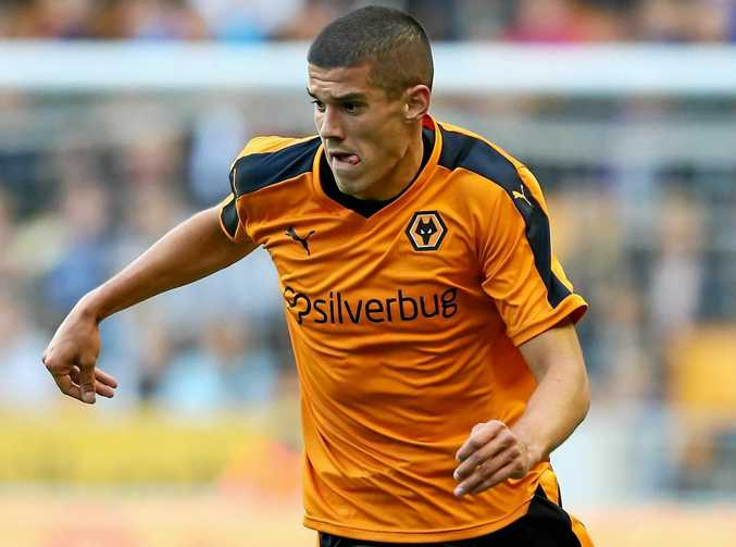 Conor Coady of Wolverhampton Wanderers runs with the ball.
