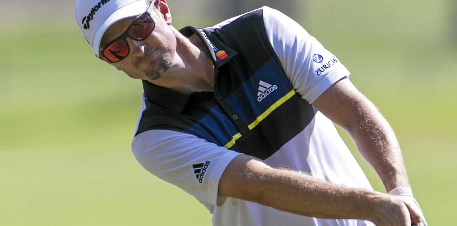 Justin Rose, of England, leads at Torrey Pines.